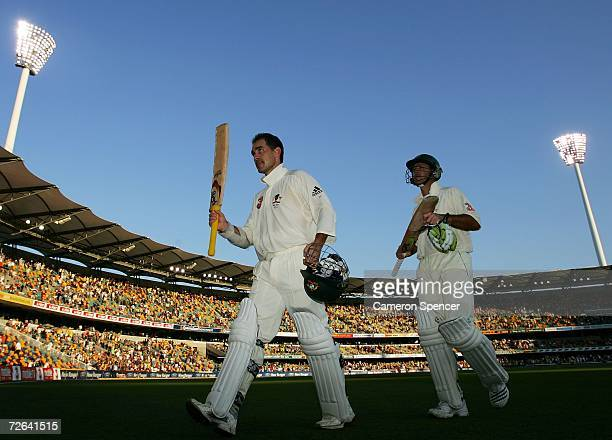 Justin Langer and Ricky Ponting of Australia leave the field at the end of play on day three of the first Ashes Test Match between Australia and...