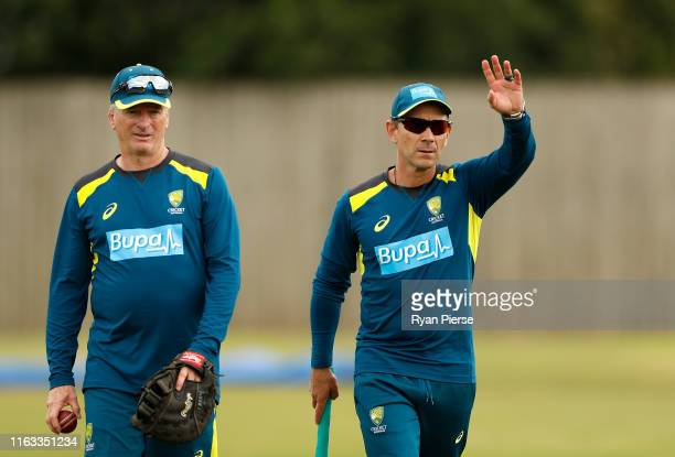 Justin Langer, coach of Australia, and Australian Team Mentor Steve Waugh talk during a training session at The Ageas Bowl in Southampton on July 21...