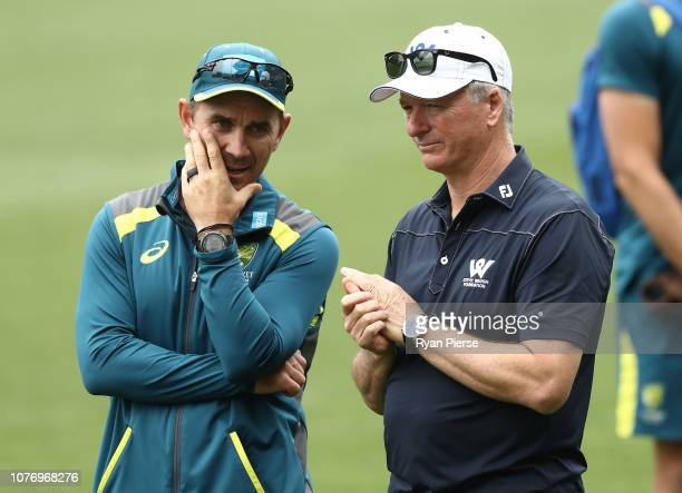 Justin Langer, coach of Australia, speaks to former Australian Captain Steve Waugh during an Australian nets session at Adelaide Oval on December 04,...