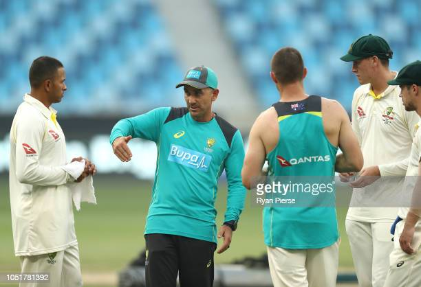 Justin Langer coach of Australia speaks with Travis Head Matt Renshaw Shaun Marsh and Usman Khawaja of Australia after play during day three of the...