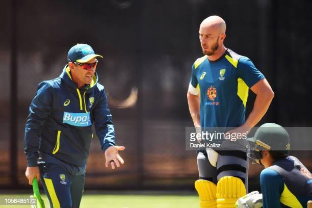 Justin Langer coach of Australia talks to Chris Lynn of Australia and Alex Carey of Australia during an Australian ODI training session/press...
