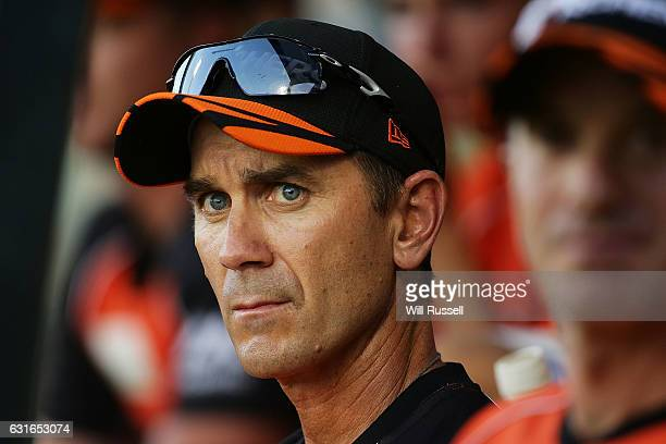 Justin Langer coach of the Scorchers looks on from the bench during the Big Bash League match between the Perth Scorchers and the Melbourne Stars at...