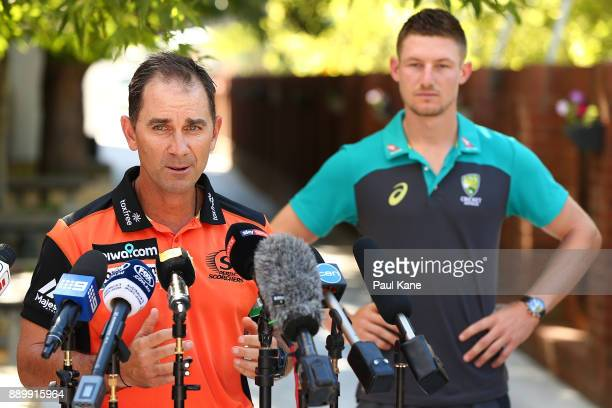 Justin Langer coach of the Western Australian Warriors and Perth Scorchers addresses the media while Cameron Bancroft of Australia looks on after...
