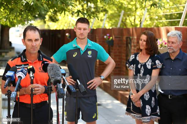Justin Langer coach of the Western Australian Warriors and Perth Scorchers addresses the media while Cameron Bancroft of Australia looks on with his...