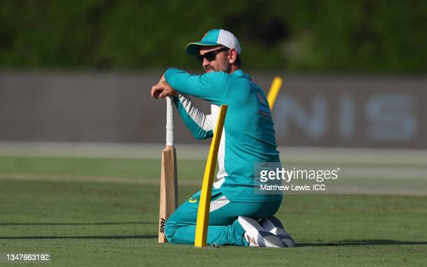 Justin Langer, Head Coach of Australia looks on during the India and Australia warm Up Match prior to the ICC Men's T20 World Cup at on October 20,...