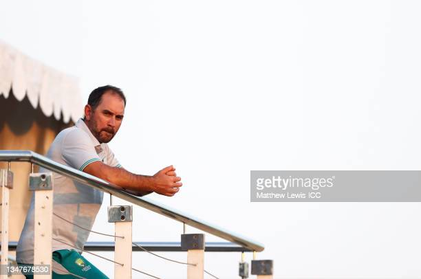 Justin Langer, Head Coach of Australia looks on following the India and Australia warm Up Match prior to the ICC Men's T20 World Cup at on October...