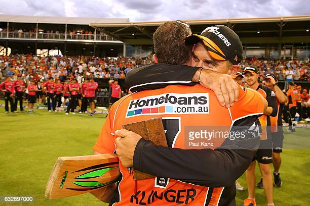 Justin Langer head coach of the Scorchers embraces Michael Klinger after winning the Big Bash League match between the Perth Scorchers and the Sydney...