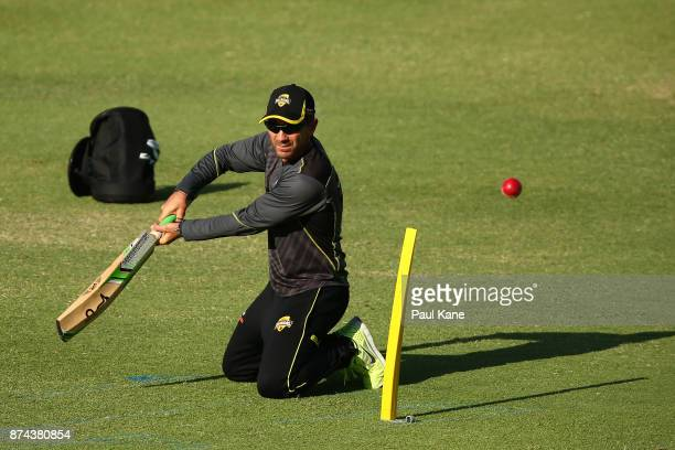 Justin Langer head coach of Western Australia hits balls for slips catching practice during day three of the Sheffield Shield match between Western...