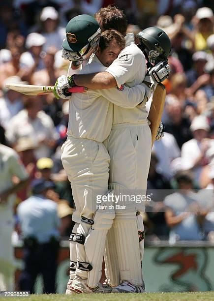 Justin Langer hugs Australian team mate Matthew Hayden after Hayden hit the winning run to beat England on day four of the fifth Ashes Test Match...