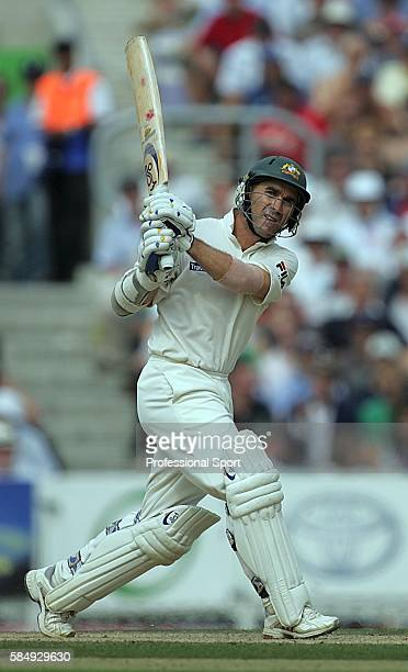 Justin Langer of Australia hits Ashley Giles of England for 6 on his way to an unbeaten 75 during day two of the 5th npower Ashes Test between...