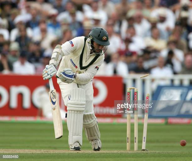 Justin Langer of Australia is bowled by Andrew Flintoff of England during day three of the Second npower Ashes Test match between England and...