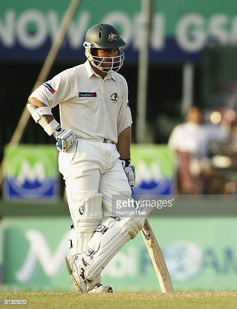 Justin Langer of Australia looks on Langer has been charged with bringing the game into disrepute after dislodging a bail whilst Hashan Tillakaratne...