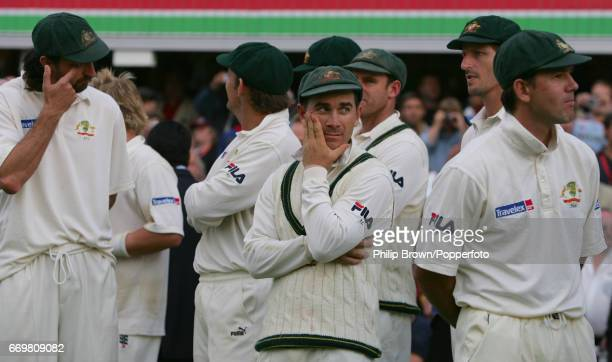 Justin Langer of Australia waits for the presentations with teammates Jason Gillespie and Ricky Ponting after the 5th Ashes Test match between...