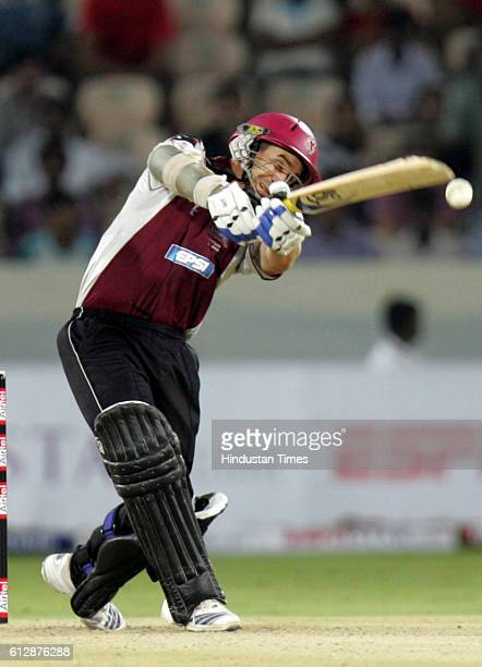 Justin Langer of Somerset drives through cover for four during the Airtel Champions League Twenty20 Group A match between the Deccan Chargers and...