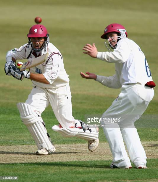 Justin Langer of Somerset plays a shot past Riki Wessels of Northamptonshire during day one of the LV County Championship match between...