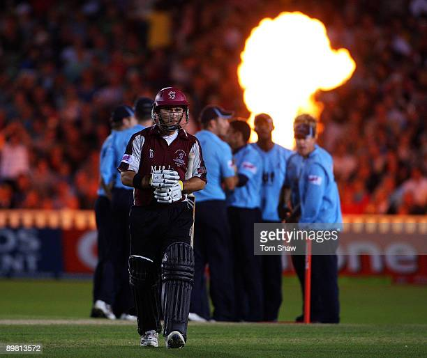 Justin Langer of Somerset walks off after he is bowled out by Yasir Arafat of Sussex during the Twenty20 Cup Final between Somerset and Sussex at...