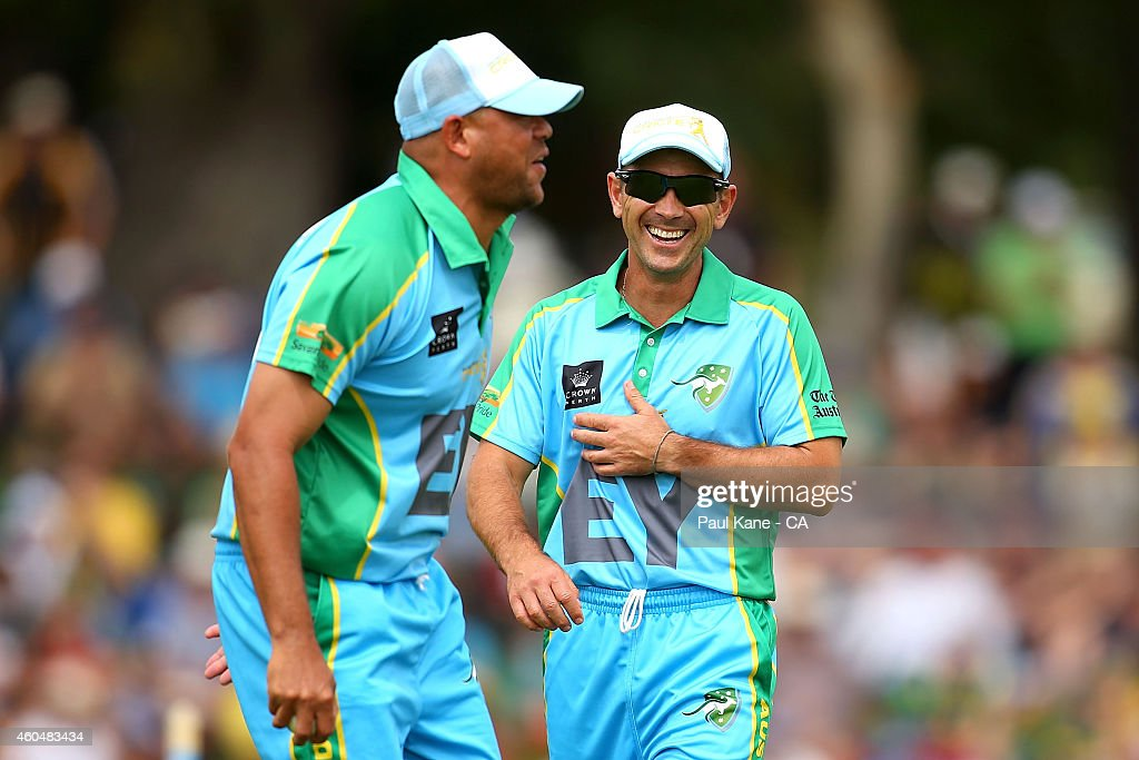Justin Langer of the Legends XI laughs with Andrew Symonds of the Legends XI during the Twenty20 match between the Perth Scorchers and Australian Legends at Aquinas College on December 15, 2014 in Perth, Australia.