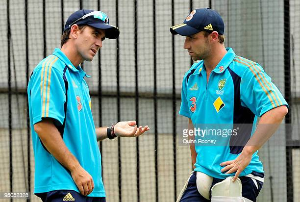 Justin Langer speaks to Phillip Hughes of Australia during an Australian nets session at Melbourne Cricket Ground on December 23 2009 in Melbourne...