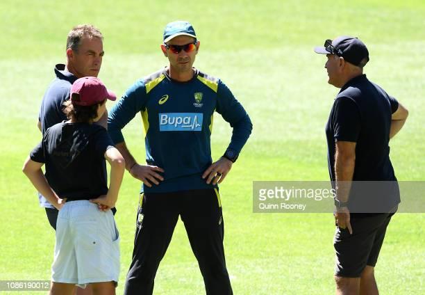 Justin Langer the Australian coach speaks to Hawks head coach Alastair Clarkson and Lions head coach Chris Fagan during an Australia training session...