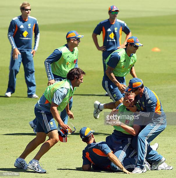 Justin Langer wrestles with Peter Siddle during an Australian training session at the WACA on December 13 2010 in Perth Australia