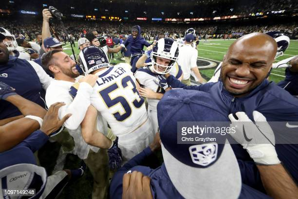 Justin Lawler of the Los Angeles Rams celebrates with his teammates after defeating the New Orleans Saints in the NFC Championship game at the...
