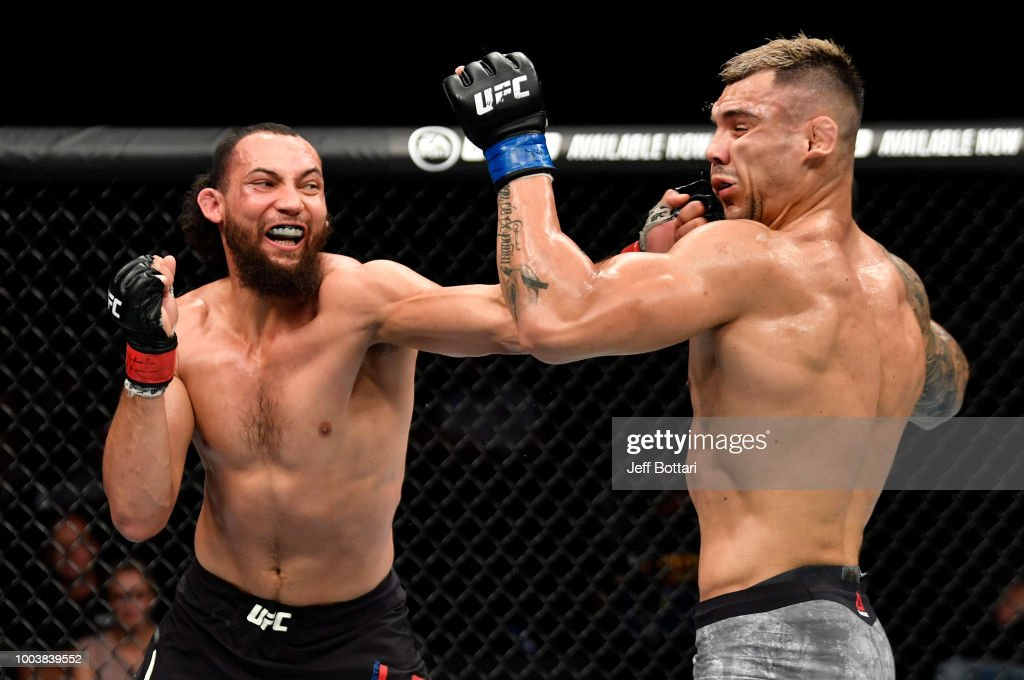 Justin Ledet punches Aleksandar Rakic of Austria in their light heavyweight bout during the UFC Fight Night at Barclaycard Arena on July 22, 2018 in Hamburg, Germany.