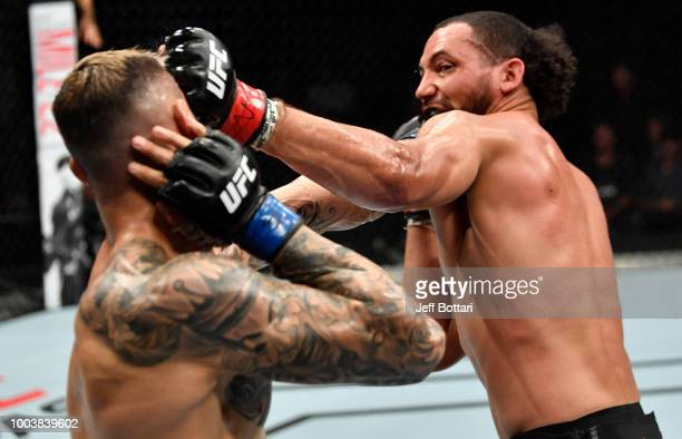 Justin Ledet punches Aleksandar Rakic of Austria in their light heavyweight bout during the UFC Fight Night at Barclaycard Arena on July 22 2018 in...