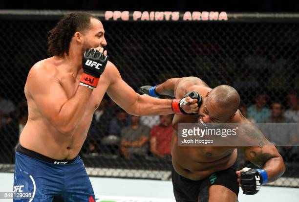 Justin Ledet punches Zu Anyanwu in their heavyweight bout during the UFC Fight Night event inside the PPG Paints Arena on September 16 2017 in...