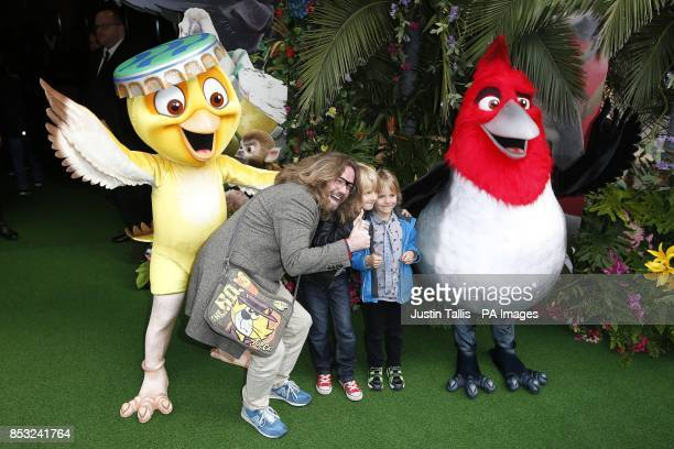 Justin Lee Collins and sons Archie and Harvey arrive for the UK gala screening of the 3D animated film Rio 2 at Leicester Square London
