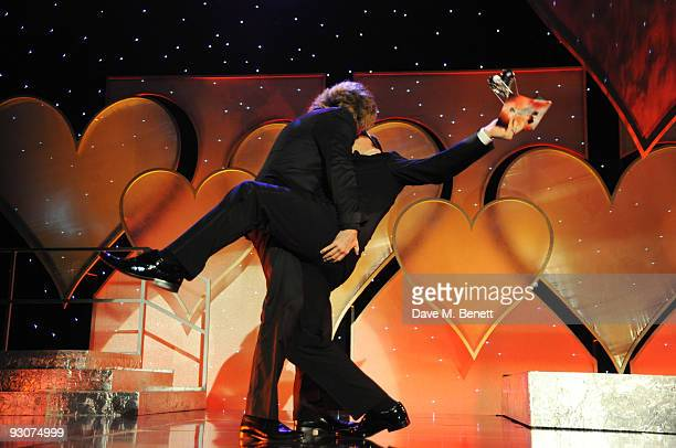 Justin Lee Collins with the Television Presenter of The Year Award presented by Alan Carr attend the Variety Club Showbiz Awards at the Grosvenor...