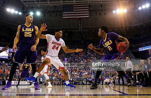 Justin Leon of the Florida Gators defends Antonio Blakeney of the LSU Tigers as Ben Simmons looks on during the second half of the game at Stephen C...