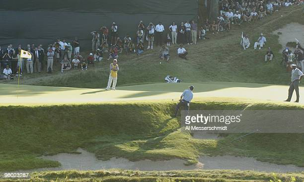 Justin Leonard chips from a front bunker near the 18th green during the final round at Whistling Straits site of the 86th PGA Championship in Haven...