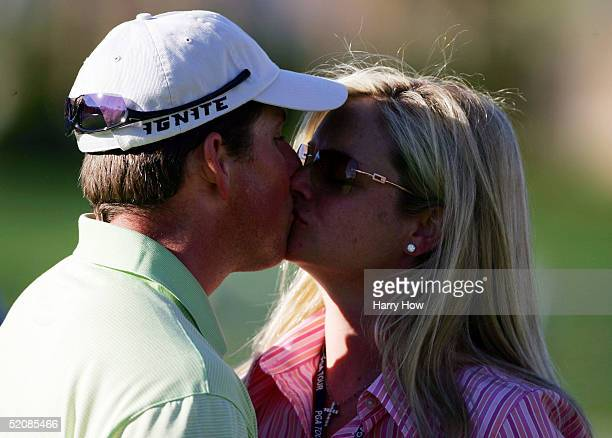 Justin Leonard gets a kiss from his wife Amanda on the 18th hole in celebration of his win during the final round of the Bob Hope Classic at the PGA...