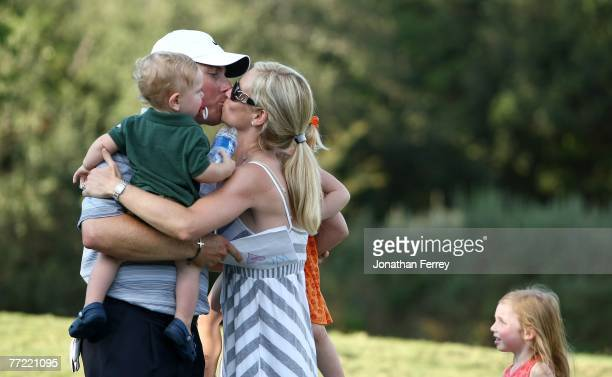 Justin Leonard kisses his wife Amanda and their children after winning the Valero Texas open at LaCantera Golf Club October 7 2007 in San Antonio...