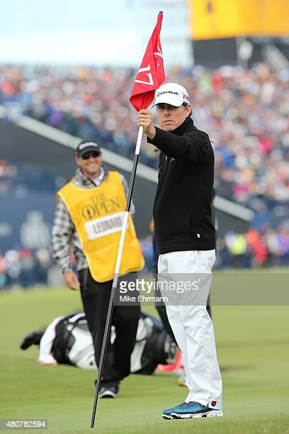 Justin Leonard of the United States tends the flag on the 17th green during the Champion Golfers' Challenge ahead of the 144th Open Championship at...