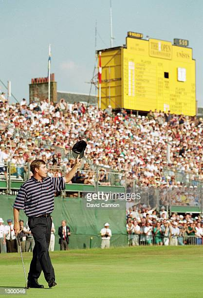 Justin Leonard of the USA acknowledges the crowd on the 18th green on his way to victory in the British Open at Royal Troon in Scotland on July 20...