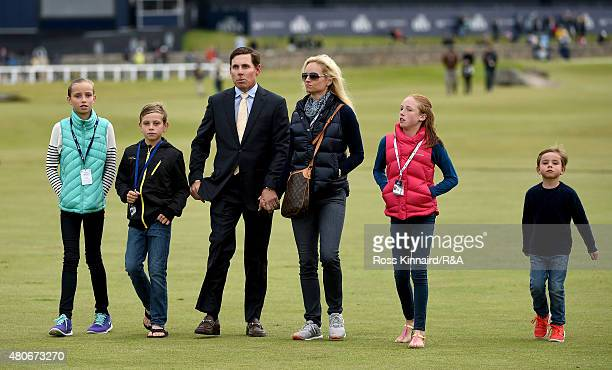Justin Leonard walks with his family as the past Open Champions gather for a photocall ahead of the 144th Open Championship at The Old Course on July...