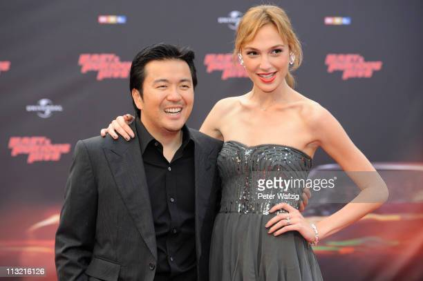 Justin Lin and Gal Godot pose at the 'Fast Furious 5' Germany Premiere on April 27 2011 in Cologne Germany