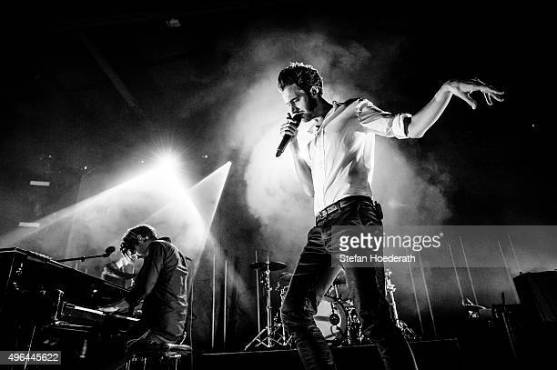 Justin Lockey and Tom Smith of the Editors perform live on stage during a concert at Columbiahalle on November 9 2015 in Berlin Germany