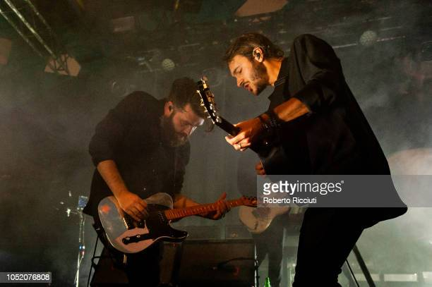 Justin Lockley and Tom Smith of Editors perform on stage at Barrowlands Ballroom on October 13 2018 in Glasgow Scotland