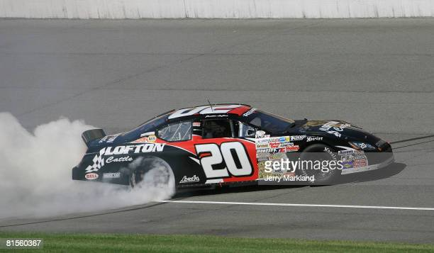 Justin Lofton driver of the Lofton Cattle Dodge does a burns out after winning the ARCA RE/MAX Series Racing for Wildlife 200 at the Michigan...