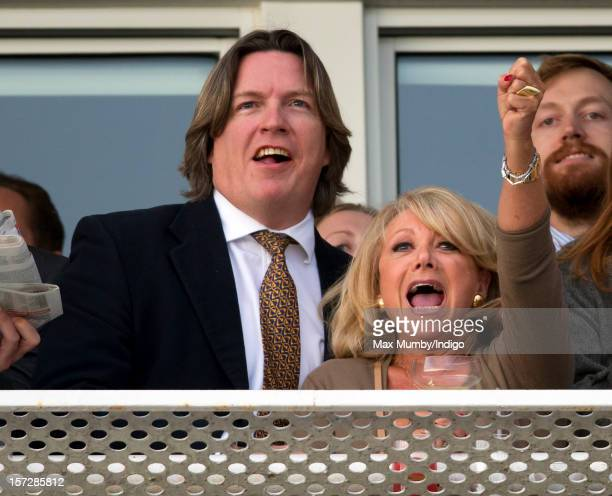 Justin Mallinson and Elaine Paige cheer as they watch the racing at the Hennessy Gold Cup at Newbury Racecourse on December 01 2012 in Newbury England