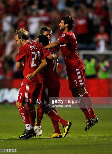 Justin Mapp Marco Pappa Krzysztof Krol and Baggio Husidic of the Chicago Fire celebrate a goal by Pappa against the Colorado Rapids in an MLS match...