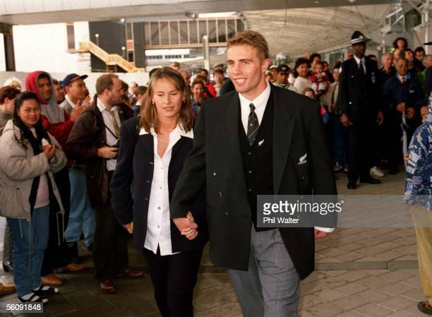 Justin Marshall and girlfriend Bernadine OliverKerby leave Auckland Airport after arriving home from the All Blacks tour to South Africa