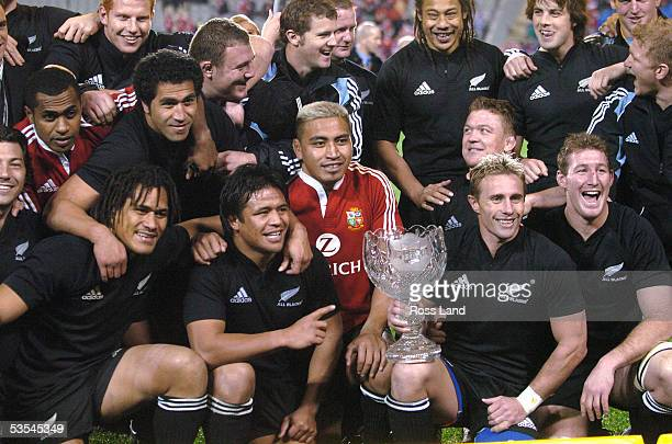 Justin Marshall holds the DHL series trophy with his team mates following the third and final rugby test won 3819 All Blacks V British and Irish...