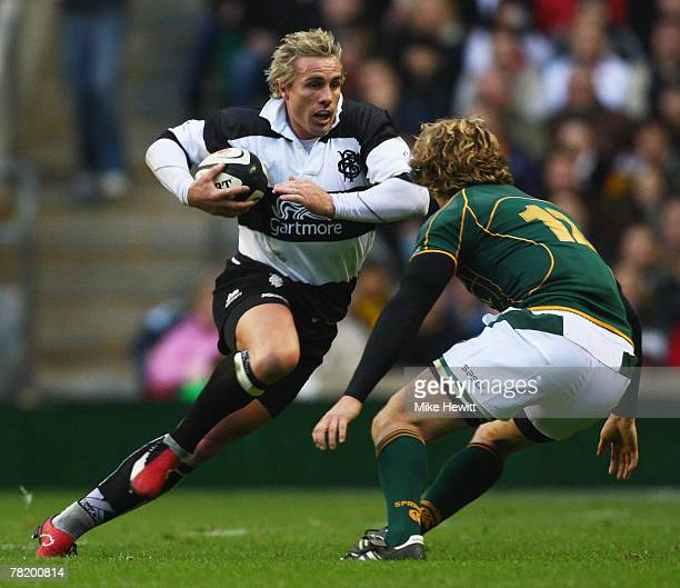 Justin Marshall of the Barbarians is challenged by Francois Steyn of South Africa during the Gartmore Challenge match between the Barbarians and...