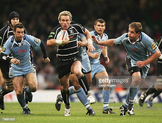 Justin Marshall of the Ospreys splits the Cardiff defence during the EDF Energy Cup Semi Final match between the Ospreys and Cardiff Blues at the...