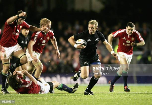 Justin Marshall the All Black scrumhalf powers away with the ball during the third test match between The New Zealand All Blacks and the British and...