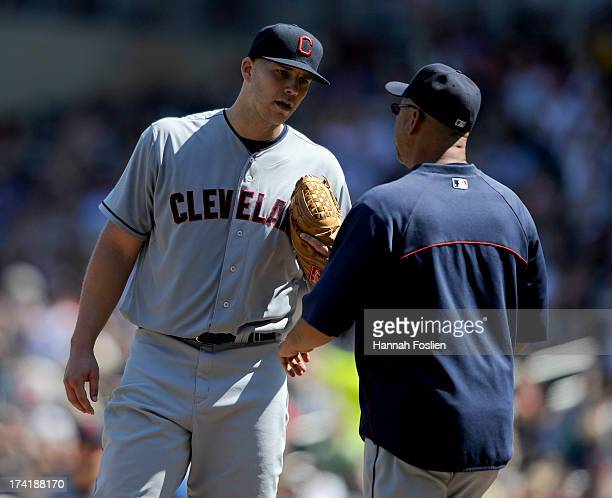 Justin Masterson and Terry Francona of the Cleveland Indians speak on the mound during the seventh inning of the game on July 21 2013 at Target Field...