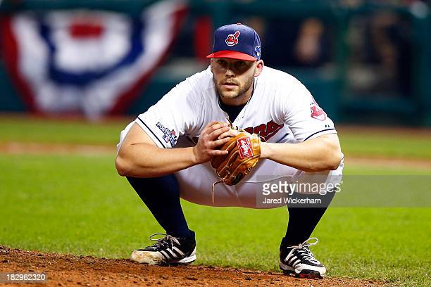 Justin Masterson of the Cleveland Indians ducks on a throw from third base to first base in the eighth inning against the Tampa Bay Rays during the...